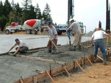 KFPD and contractors pouring concrete slab